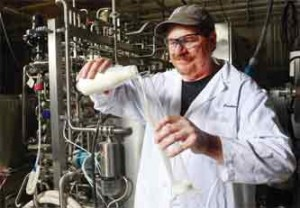 Purdue University food scientist Bruce Applegate developed a simple process that reduces harmful bacteria in milk. Credit: Purdue University/Tom Campbell