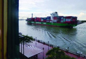View from hotel room of container ship going into port