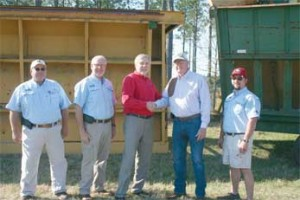 Joe West (third from left), assistant dean of the UGA Tifton Campus, shakes hands with Tom Stallings, owner of Funston Gin in Funston, Georgia. Stallings donated cotton-harvesting equipment to UGA's C.M. Stripling Irrigation Research Park (SIRP), which West oversees. Also pictured are SIRP employees (left to right) Ivey Griner, Superintendent Calvin Perry and B.J. Washington.