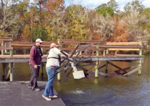 FWC staff installing a fish attractor.  FWC photo.